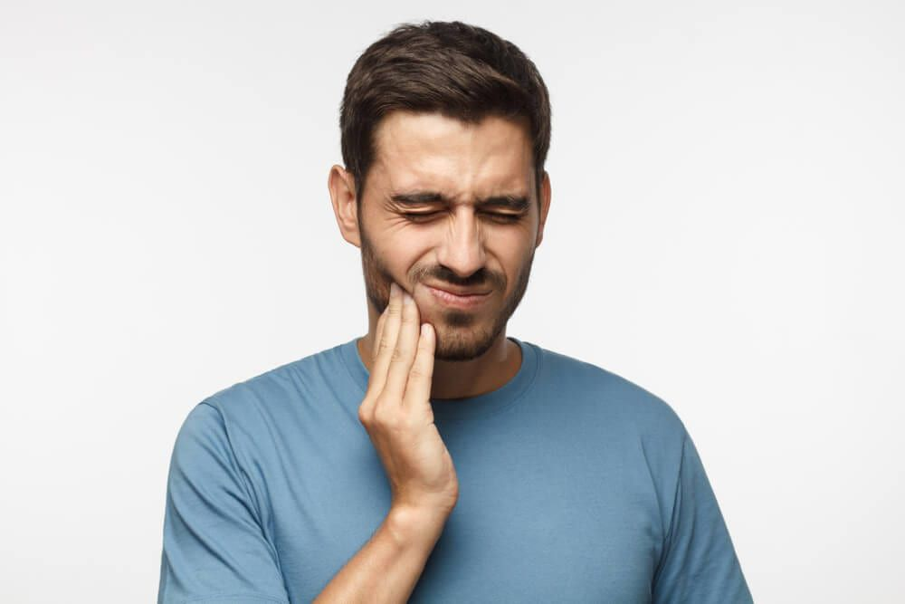 Man feeling pain in jaw